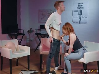 The man hot redhead takes a huge cock in ripped yoga pants