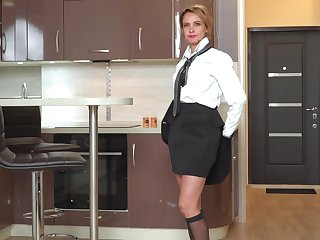 Bossy Russian woman Oliya is masturbating pussy in the kitchenette
