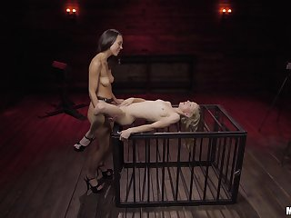 Nude lesbians share the strap-on in  their waggish femdom tryout