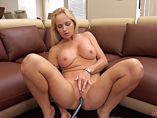 Blonde milf solo performance on a couch