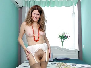 Small boobs MILF Helena Volga enjoys pleasuring her grungy pussy